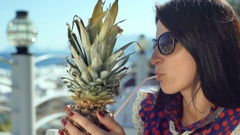 Beautiful young woman on a bar beach drinking fresh cocktail Stock Footage