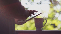 Man drinking a hot drink and check their e-mail Stock Footage