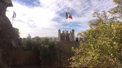 Portugal Flag In A Tower of São Jorge Castle In Lisbon, Portugal Stock Footage