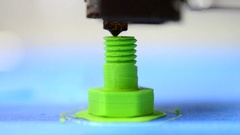3D printer prints from the plastic figure in the form bolt Stock Footage