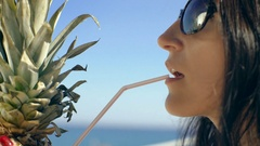 Sexy woman drinking cocktail in summer and enjoying her vacation Stock Footage