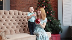 Happy mother and little son celebrate Christmas Stock Footage