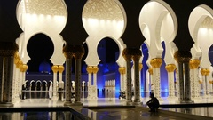 People walk in the Great Sheikh Zayed Mosque at night. Abu Dhabi , UAE Stock Footage