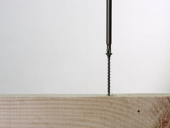 Unscrew fastener from wooden plank Stock Footage