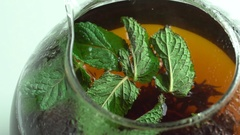 Girl throws mint leaves in a tea Stock Footage