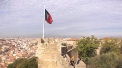 Portugal Flag On Top of São Jorge Castle, Portugal Stock Footage