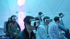 People tries virtual reality VR headset, virtual reality cinema Stock Footage