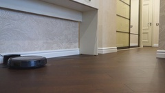 Robot vacuum cleaner start and cleaning Stock Footage