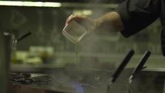 Flambé in pan slow-mo Stock Footage