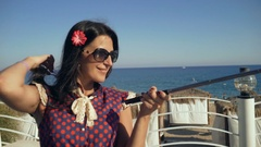 Pretty smiling female tourist taking travel selfie at the beach bar. Stock Footage