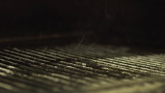Putting steak on a grill slow-mo Stock Footage