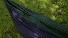 Young Woman Hides Inside Hammock, Pops Out Unexpectedly, She Laughs Really Hard Stock Footage
