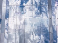 Reflection of clouds in mirror skyscrape timelapse in 4k Stock Footage