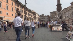 Fiumi Fountain from Piazza Navona Square with Tourists and Artist Painters. Stock Footage