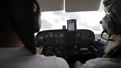 Two Pilots in a Plane Cabin Stock Footage