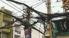 The web of power lines on the streets of Ho Chi Minh City Stock Footage