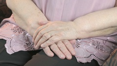 Man strokes the old woman's hands during illness Stock Footage