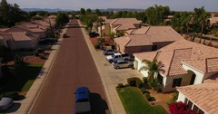 Truck Drives Past Homes in Typical Arizona Neighborhood   Stock Footage