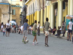 Close-up view young naughty latino cubano children play soccer on square in the Stock Footage