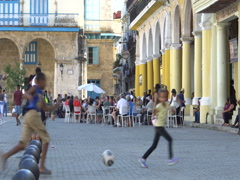 View young naughty latino cubano children teenagers play soccer on square in the Stock Footage