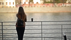 Back View of Young Woman Drinking Cup of Takeaway Coffee from Disposable Cup Stock Footage