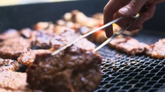 Barbecue with delicious grilled meat on grill. Barbecue party Stock Footage