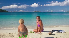 Child putting getting ready to snorkel at a tropical beach Stock Footage