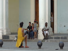 Latin American young beautiful woman girl dressed long yellow dress is sitting Stock Footage