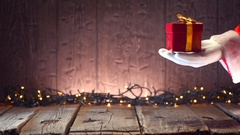 Santa Claus holding gift box, gives a gift, holding it in his hand Stock Footage