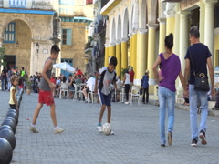 Close-up view young latino naughty cubano two children play football on square Stock Footage