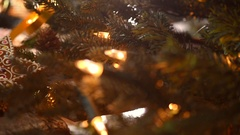 Christmas gingerbread cookies on wooden table decorated with garland and candles Stock Footage