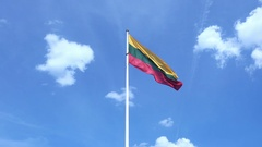 Lithuania National Flag Waving in the Wind against a Blue Sky Stock Footage