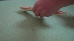 Hands arranging bamboo chopsticks on a table Stock Footage