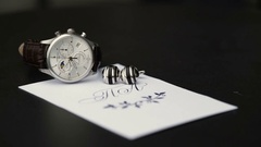 Wrist watch and cufflink timelapse Stock Footage