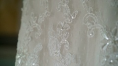 Wedding dress with lace in room Stock Footage