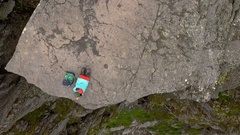 Trolltunga. Girl on the edge of a cliff Stock Footage