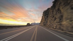 POV vehicle driving mediterranean coast countryside car travel road sunset Stock Footage