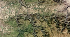 High-altitude overflight aerial of rugged front range mountains in Kazakhstan. Stock Footage