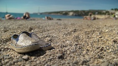 Beach Shoes Relax on Rocky Beach Stock Footage