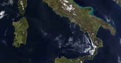 High-altitude overflight aerial of Italy and the Tyrrhenian and Adriatic Seas. Stock Footage