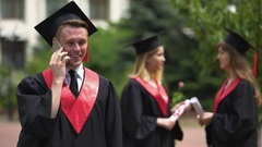 Successful student talking over phone, accepting good job offer, happy future Stock Footage