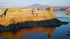 Boat moving across Lake Powell viewing a reflection of the landscape Stock Footage
