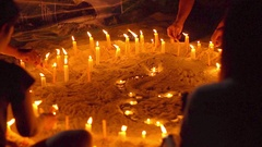 Asian candles on sand in religious ceremony , windy. Slow motion Stock Footage
