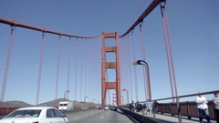 Driving across Golden Gate Bridge from driver POV with cars and people Stock Footage