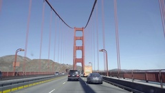 Driver POV driving across Golden Gate Bridge with cars and trucks Stock Footage