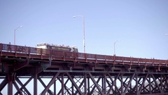 Big Bus San Francisco driving over Golden Gate Bridge on summer day California Stock Footage