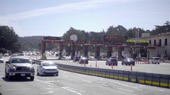 Golden Gate Bridge Toll Plaza clock on highway in San Francisco Stock Footage