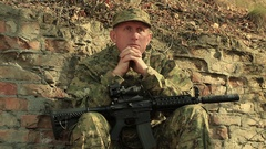 Adult soldier with automatic rifle.   Stock Footage