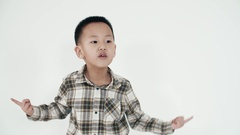 Asian boy 7years funny dancing on a white background Stock Footage