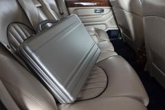 Luxury metal briefcase on the car back seat Kuvituskuvat